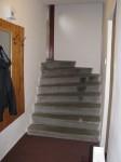 Předsíň - Za vchodovými dveřmi se sestupuje po schodech dolů do předsíně.
